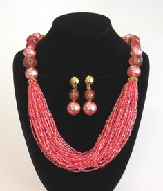 Just look at the pictures and see how beautiful this mod necklace & earrings are. This necklace features graduated glass & lucite beads with ornate goldn spacers. The front of this necklace features 28 separate draped strands of magenta pink beads. Jewelry Supplies, Jewelry Sets, Jewelry Stores, Jewelry Accessories, Custom Jewelry, Handmade Jewelry, Diy Jewelry, Beaded Jewelry, Jewelry Necklaces