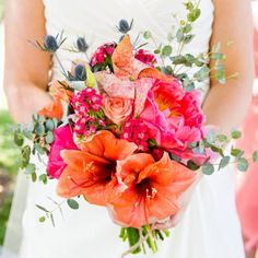 A bright and vivid bouquet adorned with a pinwheel in this Colorado wedding!