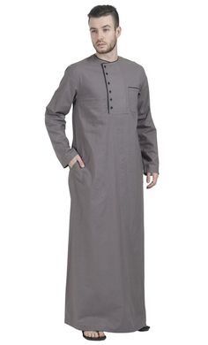 Evening Grey Dishdasha is part of Kurta men This Grey Thobe evokes ethos of Arabian nights Made out of Cotton Twill Has black piping accents on neck chest pocket Sports two side Pockets It& a - African Wear Styles For Men, African Dresses Men, African Attire For Men, African Clothing For Men, African Shirts, Arab Men Fashion, Nigerian Men Fashion, African Men Fashion, Thobes Men