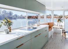 The design of this Australian houseboat features a soft, modern color palette. Here, light sage laminate kitchen cabinets are paired with leather recessed pulls. Home Renovation, Houseboat Living, Houseboat Ideas, Pontoon Houseboat, Laminate Cabinets, Kitchen Laminate, Modern Color Palette, Kitchen Cabinet Colors, Coloured Kitchen Cabinets