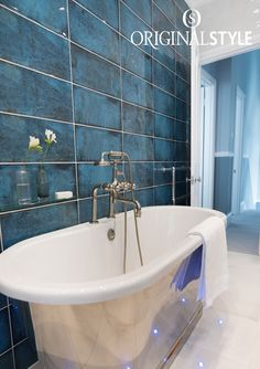 Montblanc Blue from Original Style's Tileworks collection. The stunning blue, deep gloss finish and variegated details of Montblanc will add wow factor to any bathroom wall.