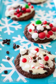 {Holiday baking with kids} Peppermint candy bark cookies: These are the perfect kid-friendly decoration cookies for the holidays. Chocolate cookie base, white chocolate frosted layer, and tons of bright candies. I'm not a huge cut-out cookie fan, so these were just right! What is your favorite holiday cookie to bake with your kids? I'm itching to get back into the kitchen!