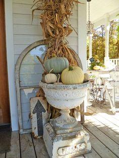 Old window, pedestal planter, sign, pumpkins.