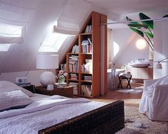 Elegant Bedroom Separator Ideas for your Limited Interior Space: Attic Master Suite Open Bedroom Bathroom With Triangle Shape Bookcase As Room Separator Ideas For Separate Master Bathroom And Rattan Bed Bedroom