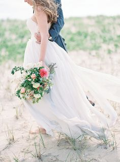 Great Point Lighthouse in Nantucket, MA. Beach wedding photography with pink and white bouquet.   - Melissa Jill Photography