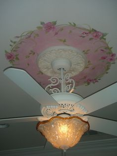 Hand painted roses with green vines on ceiling. White victorian ceiling fan with Victorian Ice Glass light.