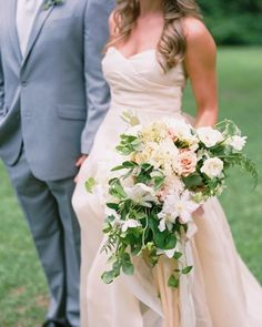 Irby carried a loose arrangement of garden roses, peonies, and clematis by Fern Studio Floral and Event Design at her South Carolina wedding.
