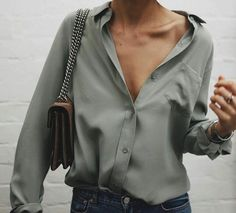 I love this: dressed down silk blouse and jeans, but a killer bag.