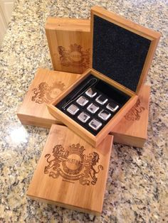 Beautiful laser engraved bamboo gift box houses nine stainless steel whiskey stones. Whiskey lovers know you don't want that tasty whiskey watered down! What a great personalized gift for the groomsmen! Get them for his birthday and as a Christmas gift for dad! #christmasgifts #personalizedgifts #laserengraved #dadgift #giftfordad #bithdaygifts #christmasgifts #boyfriendgift #whiskeystones #whiskeylover #groomsmengifts #bestmangift #fatherofthebride