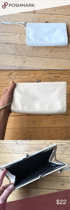 COACH Clip-top Clutch Wristlet Handbag - Authentic (Almost Vintage) COACH Handbags White Clutch / Wristlet   All leather * Inner card pocket * Top Clasp Closure * COACH logo stamp on outside    Measurements Length: 7.5 inches  Width: 1.5 inches Height: 4.5 inches   Bag is in good vintage condition - has some light wear and discolored spots throughout, notably two small indentations near logo on top front of bag (see photo.) Coach Bags Clutches & Wristlets