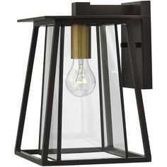 Walker has roots in the American West with its large scale, strong angular lines and no-nonsense style. The sturdy aluminum and brass construction features a two-tone finish of bold Buckeye Bronze and Heritage Brass, adding a transitional flair to its min Outdoor Wall Sconce, Outdoor Wall Lighting, Outdoor Walls, Lighting Ideas, Hinkley Lighting, Black Lamps, Wall Lantern, Wall Sconces, Wall Mount