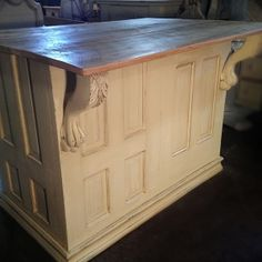 salvaged kitchen island / bar made from doors, clawfoot table base and barnwood top