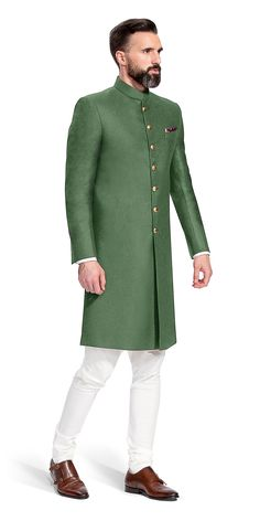 This Olive Green Achkan is an essential when it comes to ceremonial wear. It features a wool flannel fabric by Huddersfield and will pair well with dark or light pants.This Achkan features buttons that are cut from solid brass, rough buffed and plated in 24 carat gold. Hand made in Jaipur, they are detailed with enamel applied with a fine paintbrush.