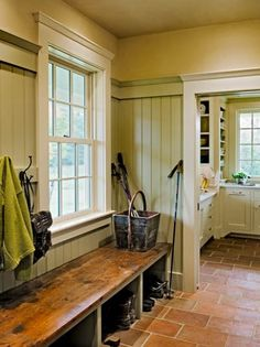 like the stained bench with cubbies (or drawers) underneath, simple hooks on the wall, beadboard, flooring