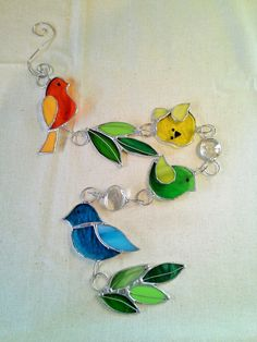 Hey, I found this really awesome Etsy listing at https://www.etsy.com/listing/385409076/stained-glass-multi-colored-birds