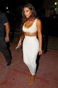 Kim Kardashian in a Yeezy crop top and midi skirt