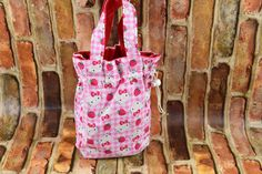 Your little girl will delight in this draw sting purse. The exterior pink cotton is adorned with Hello Kitty. The interior is lined in a red sturdy light weight canvas that complements the strawberrie Hello Kitty Purse, Birthday Gifts For Girls, Girls Bags, Girl Gifts, Little Girls, Reusable Tote Bags, Purses, Toddler Girls, Lady