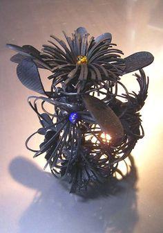 "SHINJI NAKABA | ""Wastebasket"" Rubber Brooch, Rubber - bicycle tube, amber, lapis lazuli, amazonite, chrysocolla, coral, steel, 12X6cm, 2005"