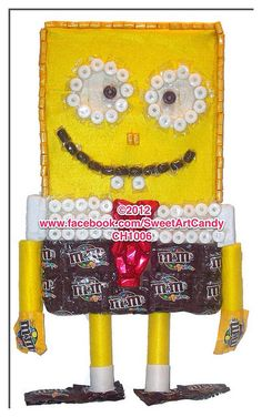 """Thinking of popping the """"BIG"""" question? Well you will need a """"BIG"""" ring to do so. Order this chocolate diamond ring created with Snickers and Hershey's Kisses. Yellow Candy, Purple Candy, Candy Art, Candy Crafts, Cookie Bouquet, Candy Bouquet, Spongebob Crafts, Root Beer Barrels, Candy Arrangements"""