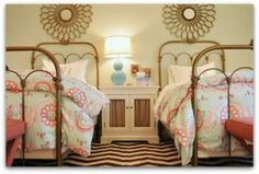iron twin beds with aqua and coral