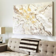 Quartz crystal or the inside of a geode could have inspired the colors of our striking hand-painted canvas, which incorporates shades of milk white, gold and pewter. Given its captivating good looks, metallic sheen and substantial size, this piece is sure to make an impressive statement when hung in a variety of interior environments.