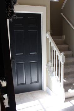 The Yellow Cape Cod: 31 Days of Character Building: Out With Oak ... paint the closet door black and paint the stair rail white