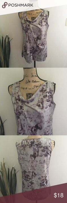 Gorgeous Vera Wang muted watercolor top Stunning light gray sleeveless top with muted watercolor purple floral details. This top is so pretty in real life and would be perfect with some gray skinny pants or jeans. Softly draped front. Sz medium Simply Vera Vera Wang Tops