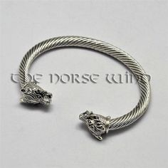 Viking Bracelet, Wolf Head Bracelet Amulet, Norse Bracelet, Norse Mythology  Viking Bracelet Amulet with Wolf Heads!  This beautiful Viking Bracelet is made from brass in silver color. In Norse mythology, Fenrir is a monstrous wolf. Fenrir is attested in the Poetic Edda, compiled in the 13th century from earlier traditional sources, and the Prose Edda and Heimskringla, written in the 13th century by Snorri Sturluson. In both the Poetic Edda and Prose Edda, Fenrir is the father of the wolves…
