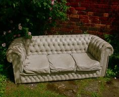Outdoor cement couch made by making a mold of an old couch!
