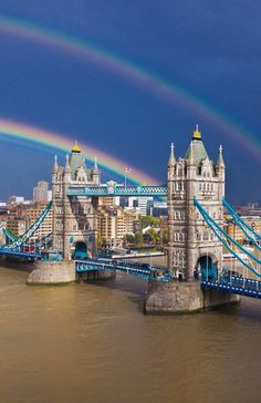 If this rainbow picture isn't on postcards, it should be. Tower Bridge in London has never looked more magical.