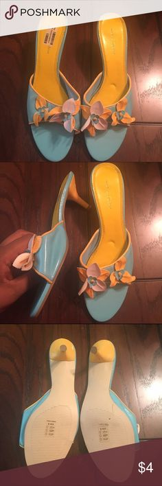 Turquoise and Yellow Flower Mules Adorable turquoise and yellow 3D flower mules. Gently worn as can be seen by the sole, with a very practical small heel. There is some peeling (see last pic) as a result of storage, NOT of wear. The shoe is in great condition! Also comes in taupe/mint green! Shoes Mules & Clogs
