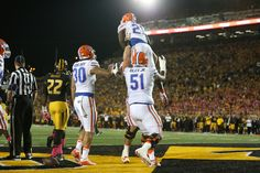 Running back Kelvin Taylor gets a lift after the first of his two rushing touchdowns on Saturday. (Photo: Tim Casey)