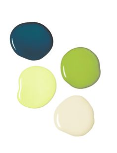 A rich exterior color palette: Olympic® Paint's Chinese Porcelain for the siding, Crumb Cookie for the trim, Aloe Vera for the mullions and a playful Asparagus green for the doors.