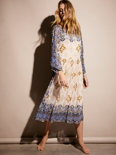 One Day Midi Dress | Gorgeous boho midi dress featuring a colorful print with heavily embellished bead and sequin detailing.    * Boat neckline and a low back.   * Statement wide sleeves.   * Pull-on silhouette.   * Removable slip with adjustable straps.