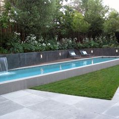 Sophisticated raised lap pool with modern detailing and water fall feature. Modern Lap Pool, Raised Lap Pool Swimming Pool Shades of Green Landscape Architecture Sausalito, CA Pool Spa, Modern Landscaping, Backyard Landscaping, Backyard Pools, Indoor Pools, Swimming Pool Landscaping, Driveway Landscaping, Tropical Landscaping, Swimming Pool Designs
