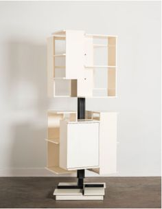 Claudio Salocchi revolving bookcase made out of white painted wood shelves and metal frame. Italy circa 1960 at Casati Gallery