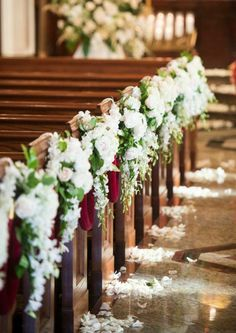 Lush pink flower markers on church pews | photography by http ...