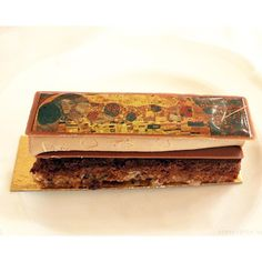 Ever eaten art? #TravelTuesday with #CafeCentralWien in #Vienna, the only place to eat a hazelnut crisp and chocolate ganache pastry with a solid chocolate layer of #Klimt's historic artwork. Full review link in bio.   Cafe Central, #Wien    #dessert #Austria #art #gustavklimt #pastry #chocolate #food #foodie #style #gourmet #luxury #lifestyle #foodblogger #onmytable #travel #foodfeed #foodstagram #fooddiary #foodinspiration #sssourabh #foodbysssourabh