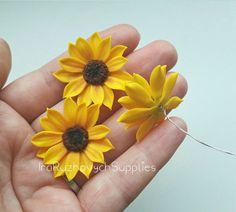 The flowers is made from polymer clay Fimo, all flowers I make myself. Diametr 30-33mm with flat base and wire.  The item will ship by Registered Air Mail Service from Ukraine. It takes about 1,5-3 weeks.