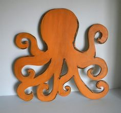Wooden octopus painted orange and distressed 24 inch tall wood octopus $47