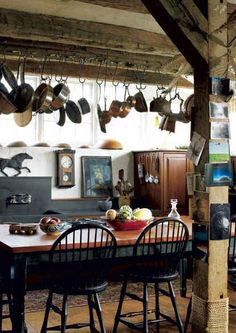 kitchen with hanging pots and wood beams