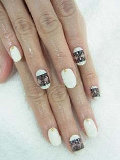 White gel nail with black lace stamp. Sophisticated black and white nail design gold jewel stud