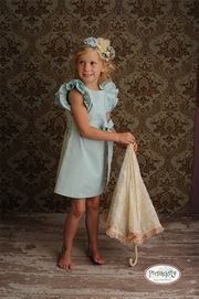 and well....she has to have this one too!!  those big blue eyes will shine bright in this dress!!! love the ruffled sleeves:)