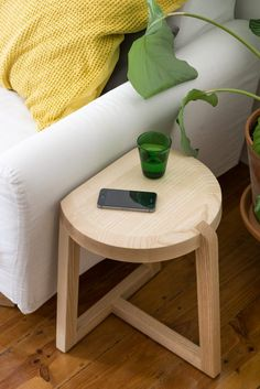Oyster stool by GeckelerMichels assisting by the sofa