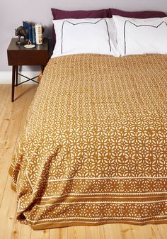 Rustic and Restful Blanket. For a nap, a good nights sleep, or even just a little escape into a good read, cozy up atop or aneath this cotton bed cover by Karma Living! #yellow #modcloth
