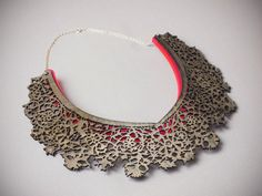 Hendrika Necklace- Laser Cut Wood and Acrylic with Sterling Silver Chain. $55.00, via Etsy.