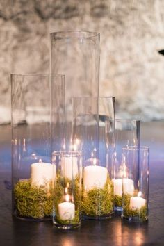 For such a romantic event as a wedding, there's really no other lighting that will do than candles. Soft and dim, candlelight can completely transform a room and warm up a space. Weddings lit by candles are almost always the… Continue Reading → Moss Centerpieces, Centerpiece Decorations, Wedding Centerpieces, Wedding Table, Our Wedding, Wedding Decorations, Moss Wedding Decor, Trendy Wedding, Wedding Reception