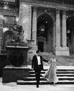 LOVE this classic picture of a couple walking in snow, dressed up