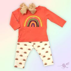Somewhere over the rainbow, skies are blue & dreams that you dream really do come true!!!   #OutfitOfTheDay #LooksWeLove #Bows #WeeOnes #FashionBabies #TShirt #Leggings #RainbowPrint