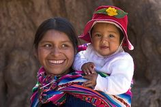 Mother and child, Pisac market, Peru